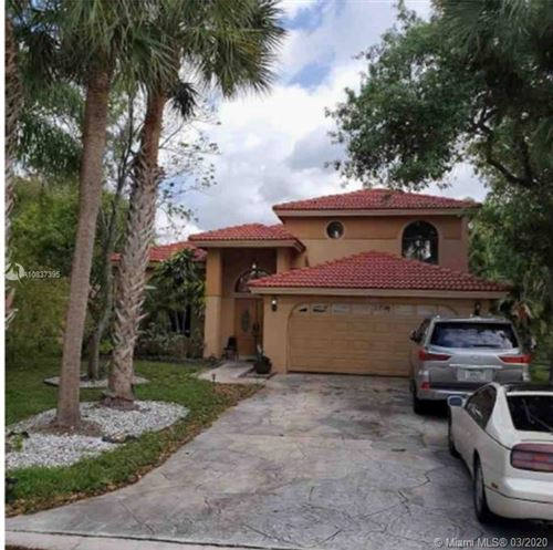 Photo of 221 NW 118th Ave, Coral Springs, FL 33071 (MLS # A10837395)