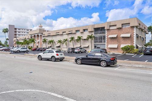 Photo of 300 Golden Isles Drive #117, Hallandale Beach, FL 33009 (MLS # A11114396)
