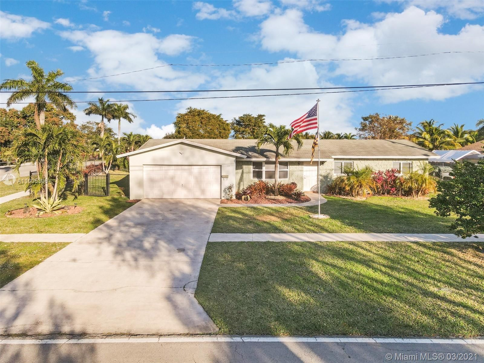 Photo of 320 NW 43rd Ave, Coconut Creek, FL 33066 (MLS # A11005396)