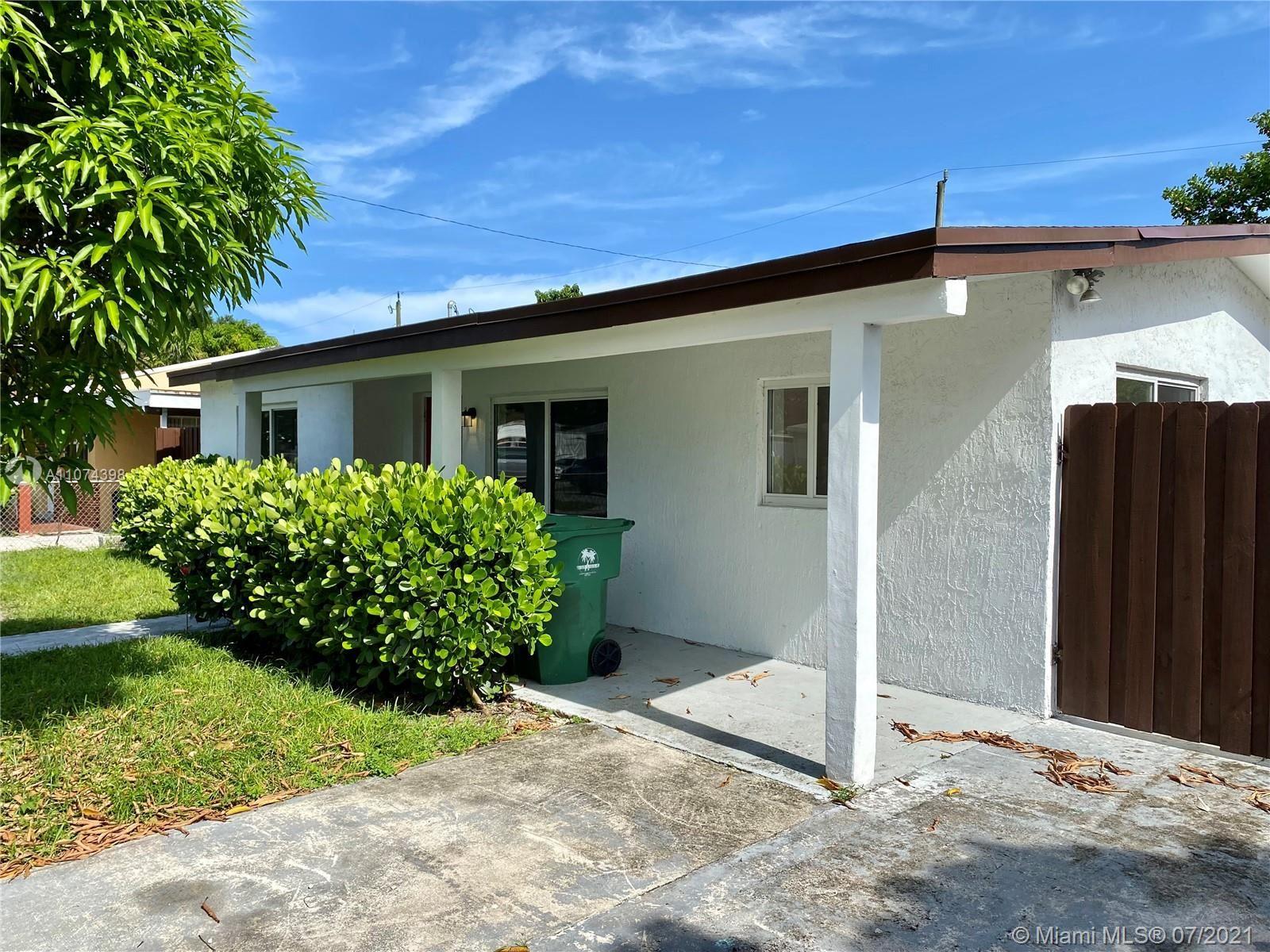 Photo of 6518 SW 23rd St, Miramar, FL 33023 (MLS # A11074398)