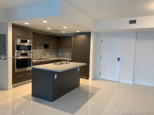 Photo of 7825 NW 107th Ave #307, Doral, FL 33178 (MLS # A11009399)