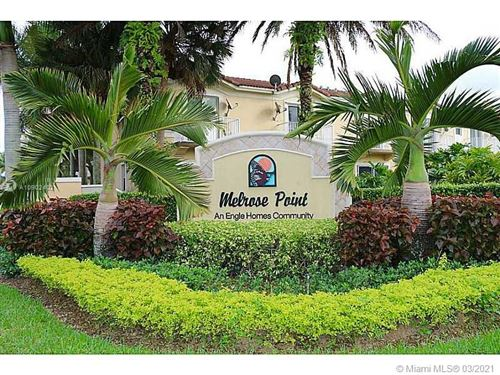 Photo of 12882 SW 31st St #144, Miramar, FL 33027 (MLS # A10902402)