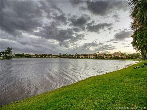 Photo of 12044 SW 5th Ct #12044, Pembroke Pines, FL 33025 (MLS # A10960403)