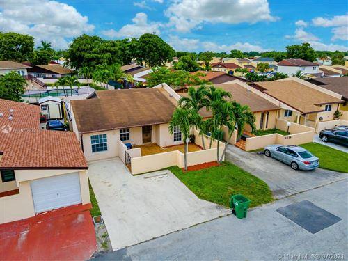 Photo of 5554 NW 194th Ln, Miami Gardens, FL 33055 (MLS # A11075408)