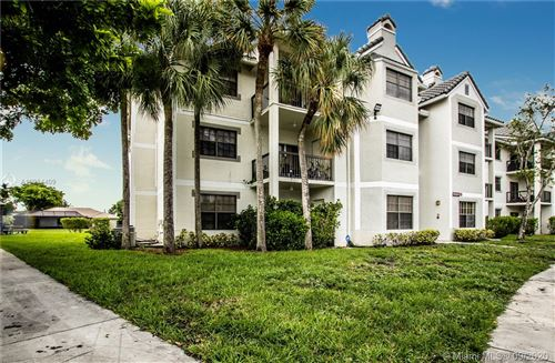 Photo of 11205 W Atlantic Blvd #101, Coral Springs, FL 33071 (MLS # A10934409)