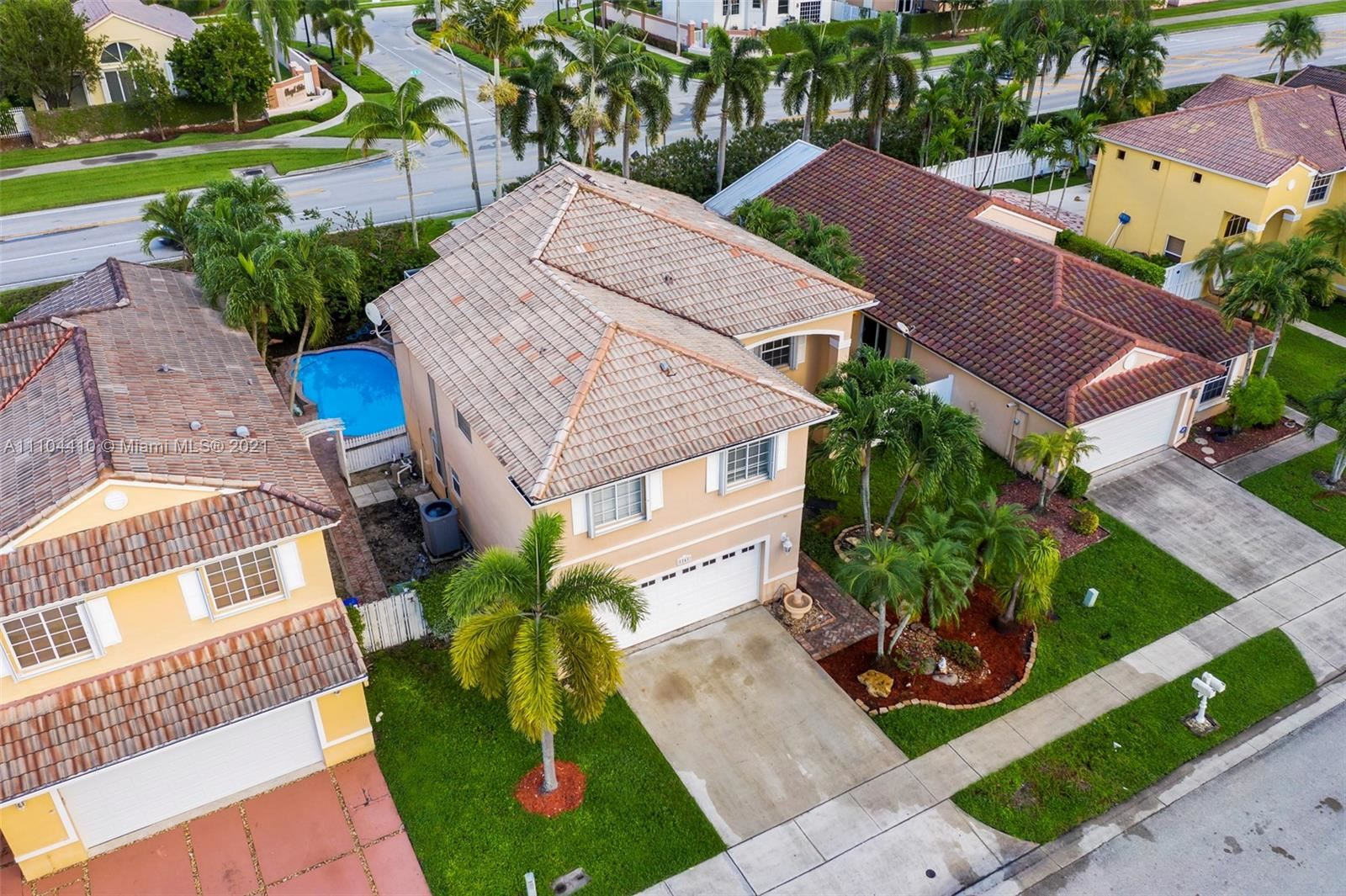 Photo of 1241 NW 187th Ave, Pembroke Pines, FL 33029 (MLS # A11104410)