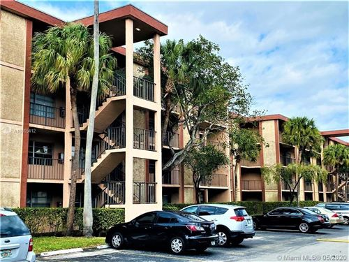 Photo of 3070 NW 48th Terrace #204, Lauderdale Lakes, FL 33313 (MLS # A10865412)