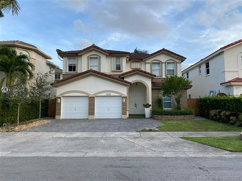 Photo of 11554 NW 83rd Way, Doral, FL 33178 (MLS # A10930412)