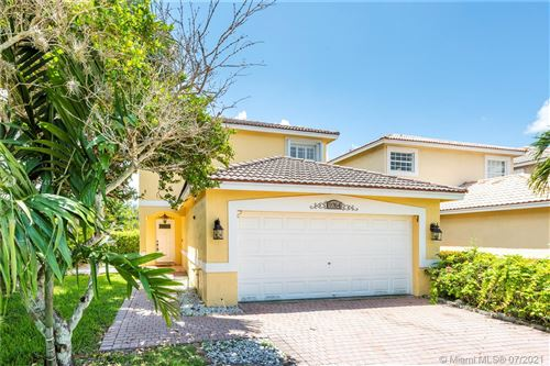 Photo of 9764 NW 1st Mnr, Coral Springs, FL 33071 (MLS # A11077412)
