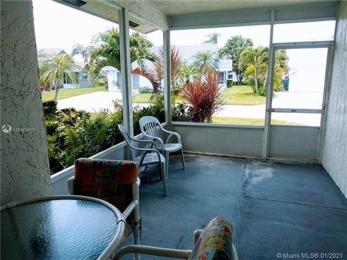 Photo of 3859 W ROWENA, West Palm Beach, FL 33417 (MLS # A10862413)