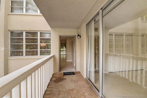 Photo of 7021 Environ Blvd #215, Lauderhill, FL 33319 (MLS # A11055414)