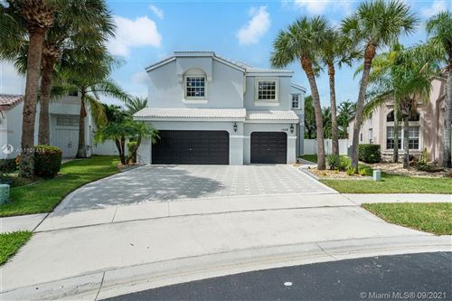 Photo of 1428 NW 158th Ln, Pembroke Pines, FL 33028 (MLS # A11101414)