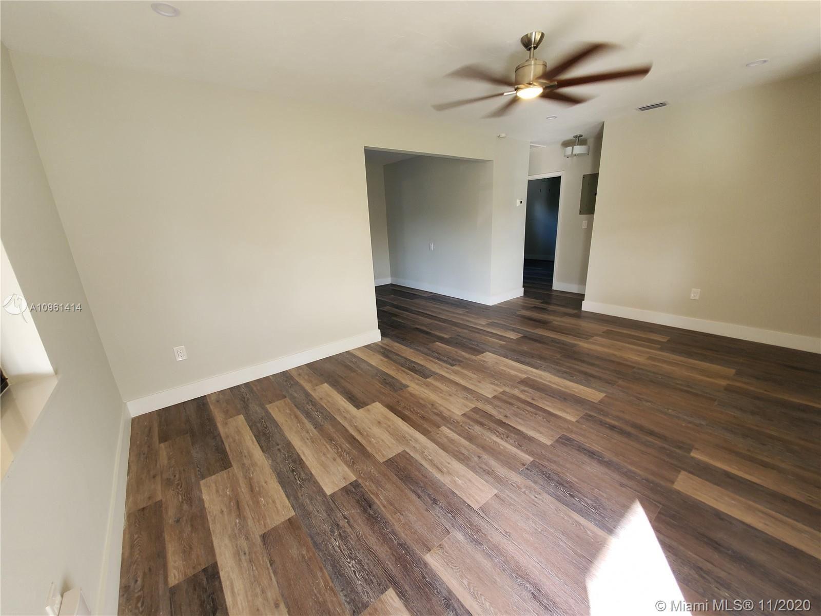 Photo of 7041 SW 12th St, Pembroke Pines, FL 33023 (MLS # A10961414)