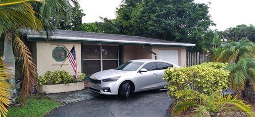 Photo of 8850 Johnson St, Pembroke Pines, FL 33024 (MLS # A11071415)