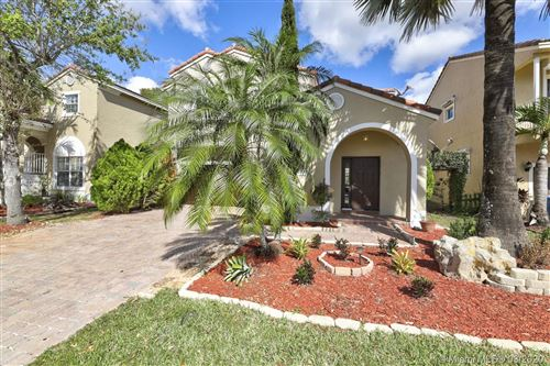 Photo of 939 NW 127th Ave, Coral Springs, FL 33071 (MLS # A10837417)