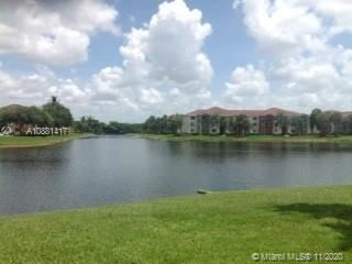 Photo of 7765 Yardley Dr #313, Tamarac, FL 33321 (MLS # A10881417)