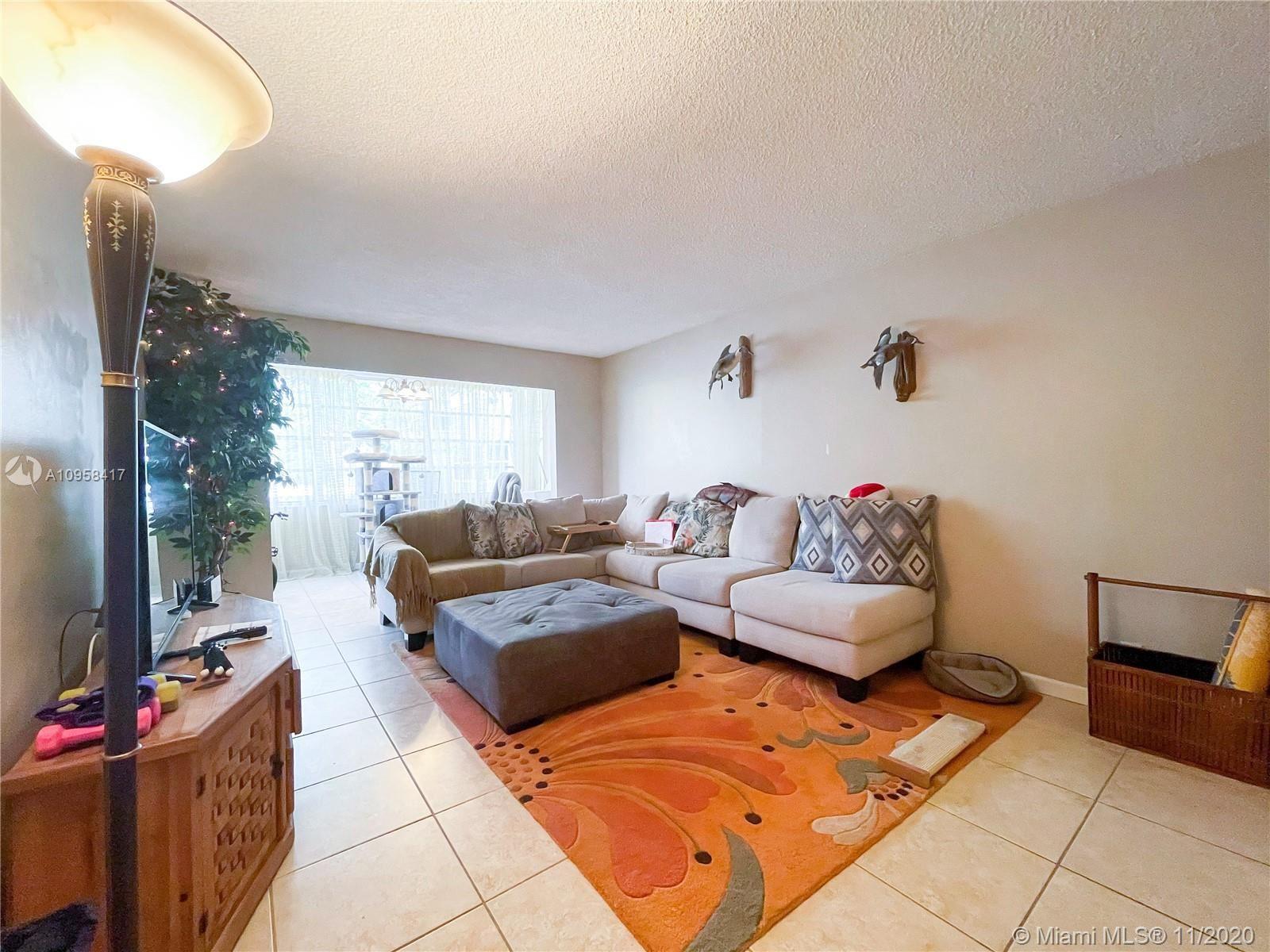 Photo of 6700 Cypress Rd #212, Plantation, FL 33317 (MLS # A10958417)