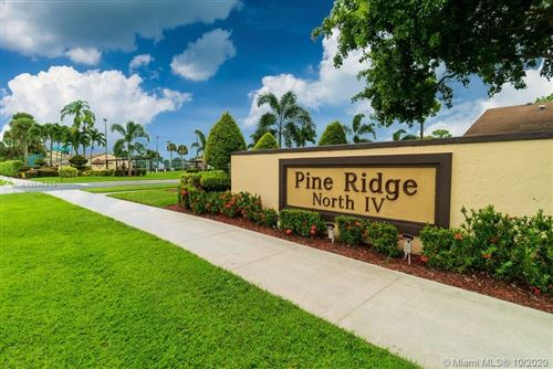 Photo of 803 Sky Pine Way #D, Green Acres, FL 33415 (MLS # A10946419)