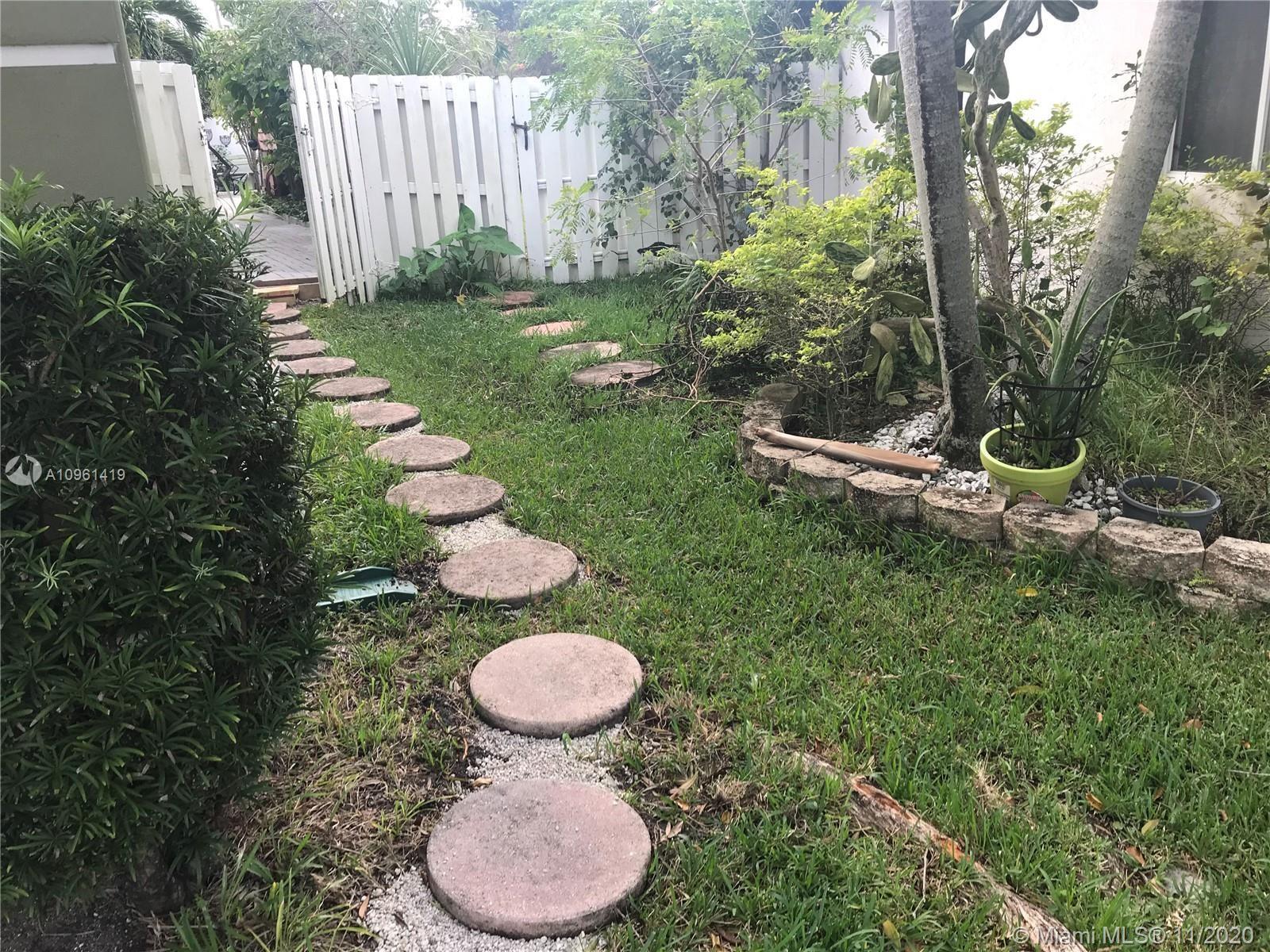 Photo of 721 NW 135 Way #721, Plantation, FL 33325 (MLS # A10961419)