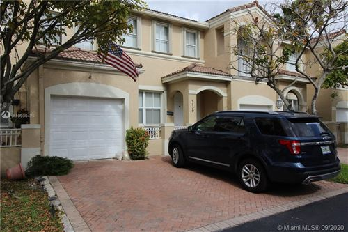 Photo of 3120 NW 101st Pl, Doral, FL 33172 (MLS # A10930420)