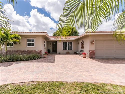Photo of 8742 NW 18th Ct, Coral Springs, FL 33071 (MLS # A10837422)