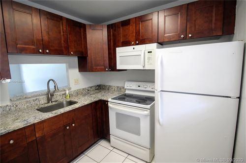 Photo of 5011 W Oakland Park Blvd #305, Lauderdale Lakes, FL 33313 (MLS # A10919422)