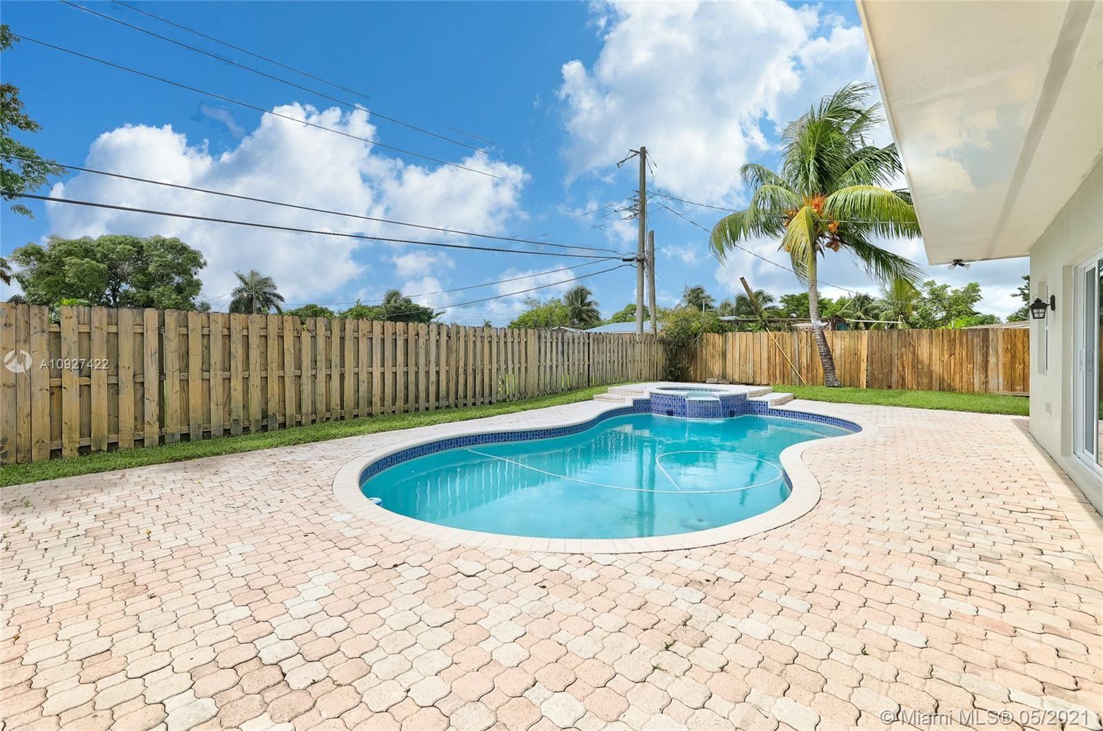 Photo of 6118 Hogan Creek Rd, Margate, FL 33063 (MLS # A10927422)