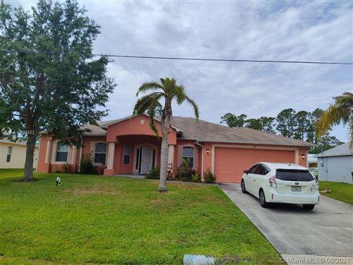 Photo of 732 NE Americana Blvd, Palm Bay, FL 32907 (MLS # A11047423)