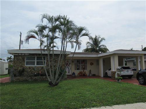 Photo of 7570 Buchanan St, Hollywood, FL 33024 (MLS # A11116423)