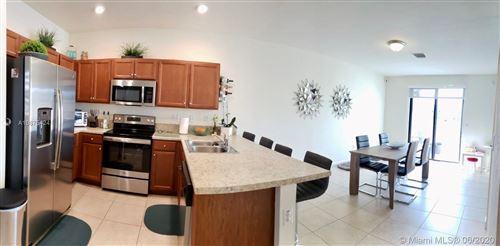 Photo of 9382 W 34 Ct #9382, Hialeah Gardens, FL 33018 (MLS # A10875424)