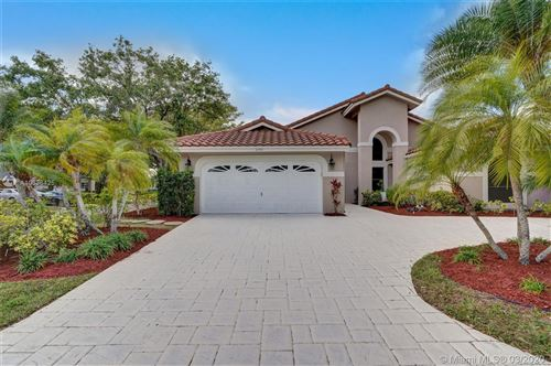Photo of 2140 Oakland Hills Way, Coral Springs, FL 33071 (MLS # A10836425)