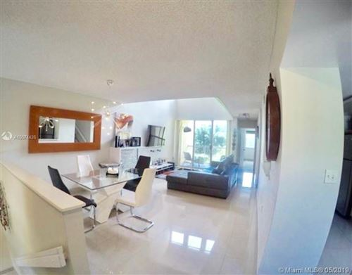 Photo of 9735 NW 49th Ter #414, Doral, FL 33178 (MLS # A10674426)