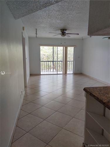 Photo of 7910 N Colony Cir N #308, Tamarac, FL 33321 (MLS # A10878426)