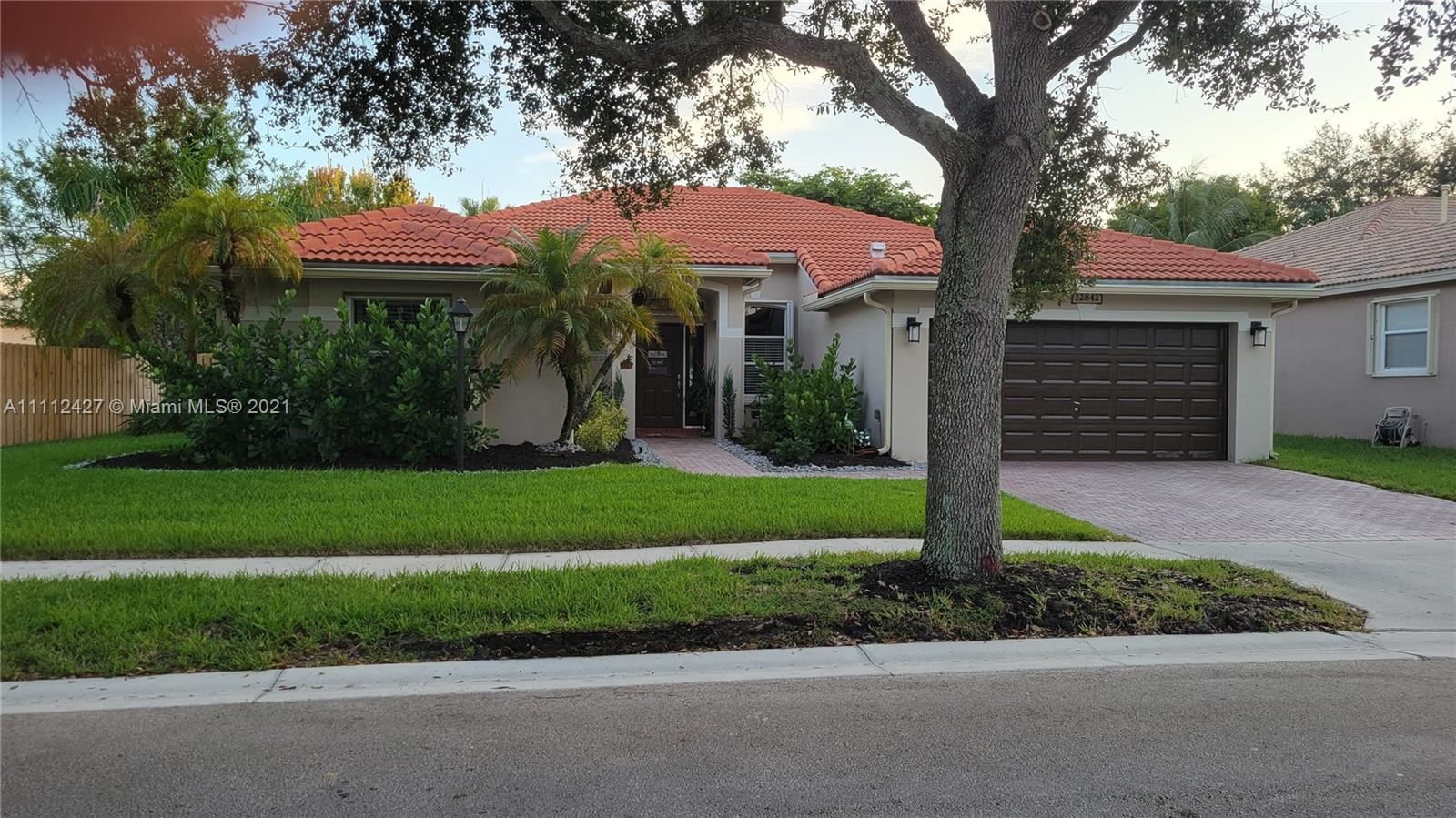 Photo of 12842 NW 18th Ct, Pembroke Pines, FL 33028 (MLS # A11112427)