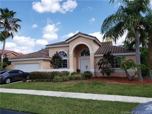 Photo of 945 NW 199th Ter, Pembroke Pines, FL 33029 (MLS # A10639428)