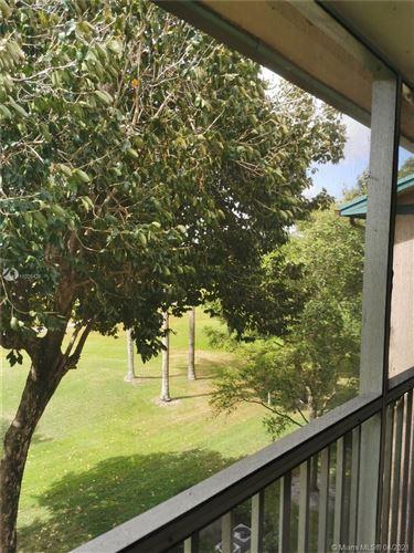 Photo of 12650 SW 6th St #402K, Pembroke Pines, FL 33027 (MLS # A11026428)