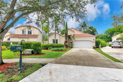 Photo of 1721 Harbour Side Dr, Weston, FL 33326 (MLS # A10865429)