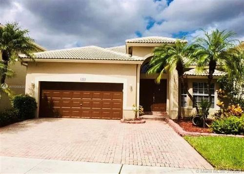 Photo of 1244 NW 167th Ave, Pembroke Pines, FL 33028 (MLS # A11058430)