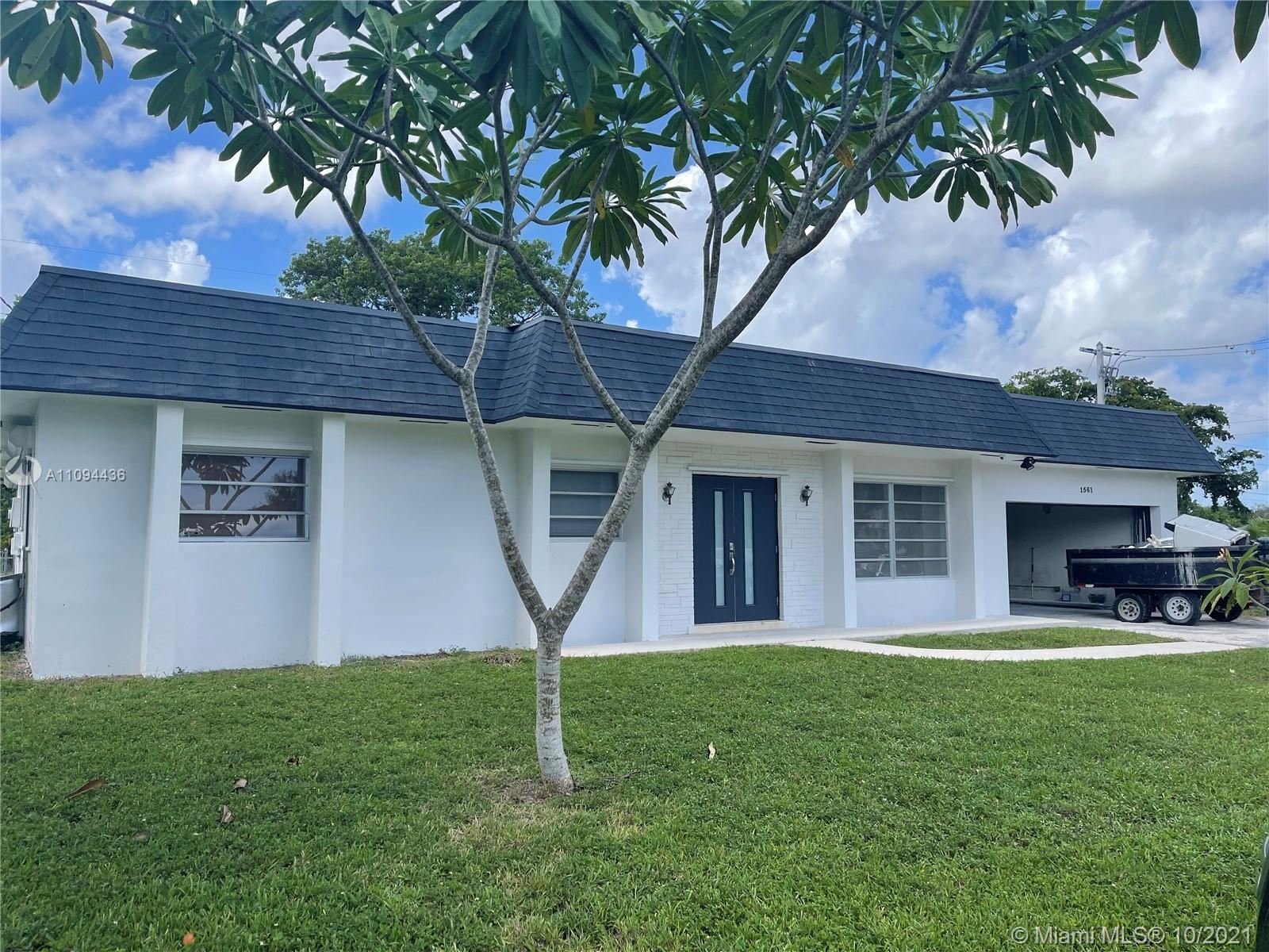 Photo of 1561 NW 75th Ter, Plantation, FL 33313 (MLS # A11094436)