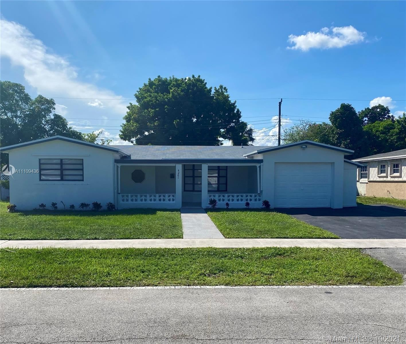 Photo of 4261 NW 36th Ter, Lauderdale Lakes, FL 33309 (MLS # A11109436)