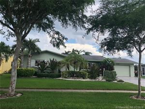 Photo of 4120 NW 10th St, Coconut Creek, FL 33066 (MLS # A10715438)