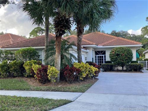 Photo of 136 Lost Bridge Dr, Palm Beach Gardens, FL 33410 (MLS # A11008438)