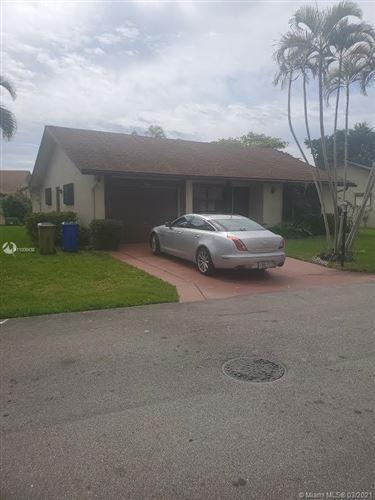 Photo of 2030 SW 16th Pl, Deerfield Beach, FL 33442 (MLS # A11009438)