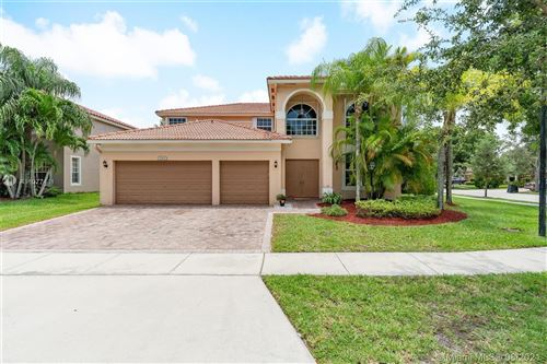Photo of 1303 NW 133rd Ave, Pembroke Pines, FL 33028 (MLS # A11077441)