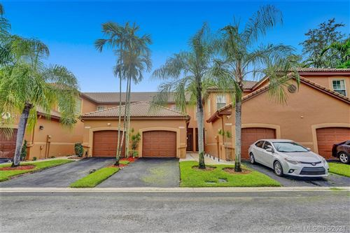 Photo of 1530 Coronado Rd, Weston, FL 33327 (MLS # A11058445)