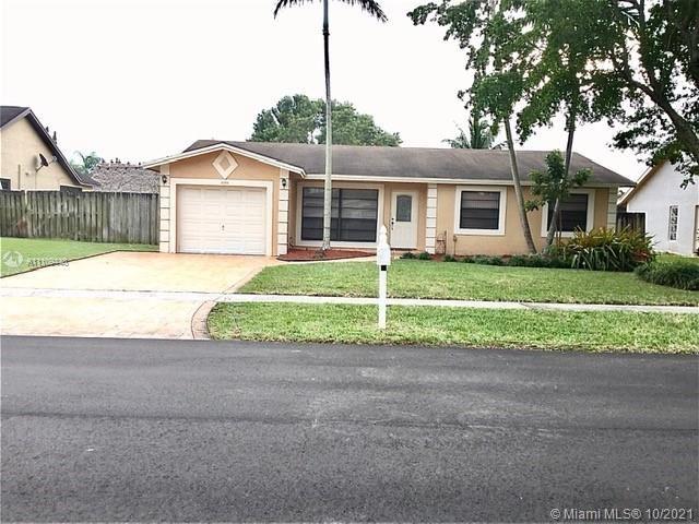 Photo of 8350 NW 7th St, Pembroke Pines, FL 33024 (MLS # A11109448)