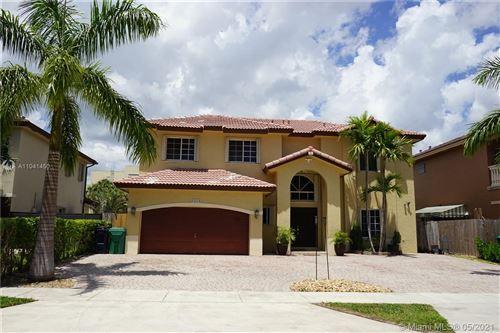 Photo of 14428 SW 158th Path, Miami, FL 33196 (MLS # A11041450)