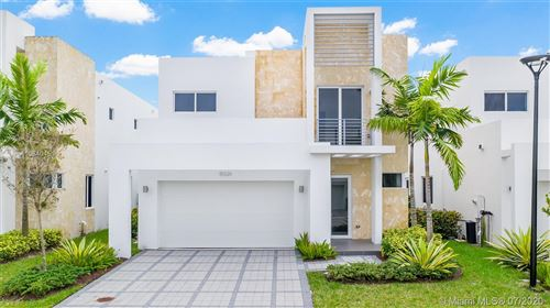 Photo of 6845 NW 103rd PL, Doral, FL 33178 (MLS # A10840451)
