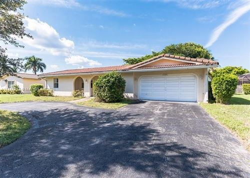Photo of 11241 NW 43rd St, Coral Springs, FL 33065 (MLS # A11117452)