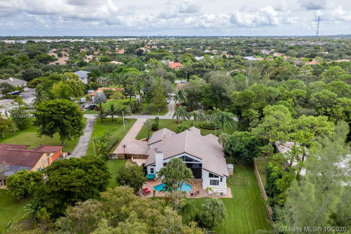 Photo of 6343 NW 62nd Ter, Parkland, FL 33067 (MLS # A10945453)